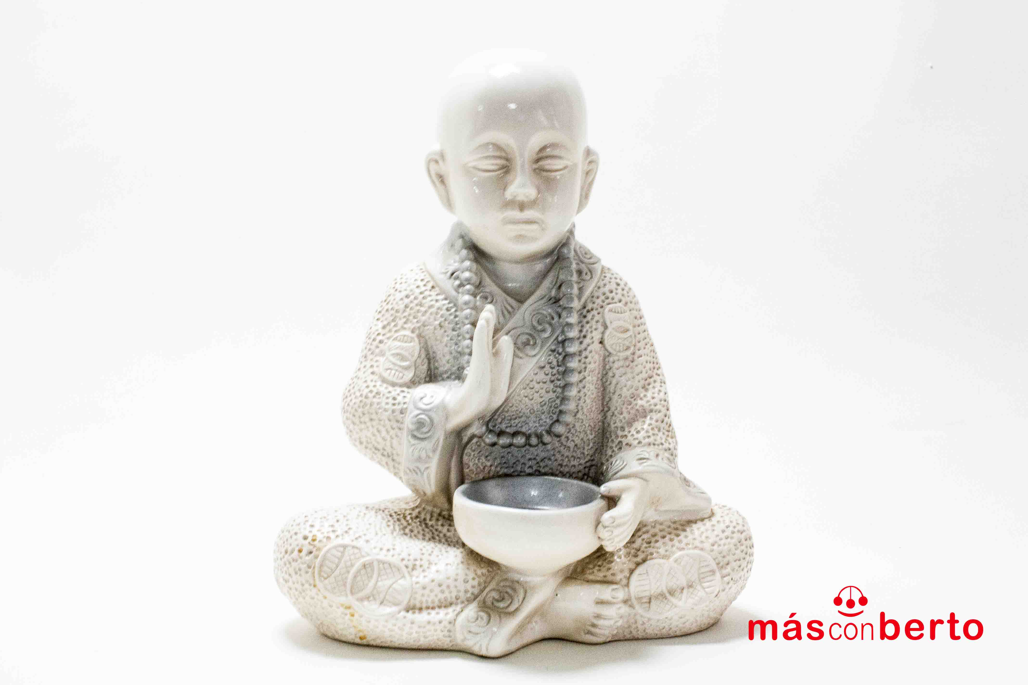 Buda sentado con cuento...
